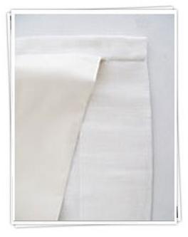 Foder från Ada & Ina. Tyget är vitt och förändrar inte själva gardintygets lyster.